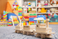 Wooden train in the play room Royalty Free Stock Photography