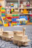 Wooden train in the play room Stock Photography