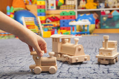 Wooden train in the play room Royalty Free Stock Images