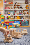 Wooden train in the play room. And many toys Royalty Free Stock Image
