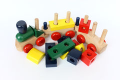 Wooden train toy. A colorful wooden train toy for children on white paper Stock Photography