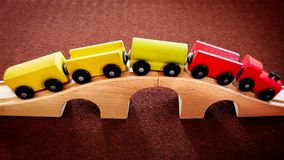Wooden Train Toy on the Bridge. Closeup Wooden Train Toy on the Bridge Royalty Free Stock Images