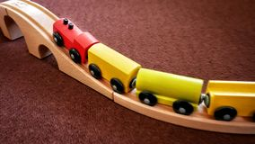Wooden Train Toy Moving Up the Bridge. With Speed Royalty Free Stock Images