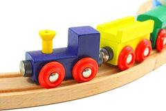 Wooden train toy on rails  on white Royalty Free Stock Photo