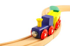 Wooden train toy on rails  on white Stock Images