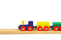 Wooden train toy on rails  on white. Background Royalty Free Stock Image