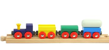 Wooden train toy on rails on white Royalty Free Stock Images
