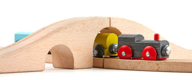 Wooden train toy under bridge Stock Photo