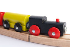 Wooden train on a track Stock Photo