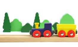 Wooden train and trees isolated over white Royalty Free Stock Photo