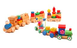 Wooden trains puzzle with coaches Royalty Free Stock Images