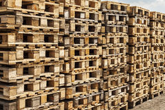Wooden transport pallets in stacks. Royalty Free Stock Photo