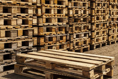 Wooden transport pallets in stacks. Royalty Free Stock Photography