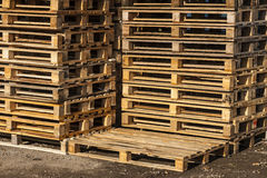 Wooden transport pallets in stacks. Wooden transport pallets in stacks ready for delivery. One palette in the foreground Stock Image