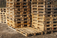 Wooden transport pallets in stacks. Royalty Free Stock Photos