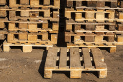 Wooden transport pallets in stacks. Wooden transport pallets in stacks ready for delivery. One palette in the foreground Stock Photos