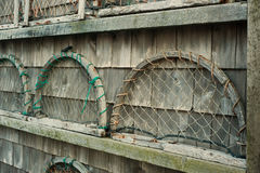 Wooden trap ends on wall. Wooden lobster trap ends on a shingled wall Stock Photo