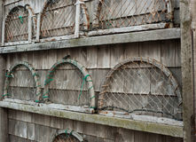 Wooden trap ends on wall. Wooden lobster trap ends on a shingled wall Royalty Free Stock Images