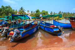 Wooden travel boats are in the harbor  in Goa, India. Stock Photos
