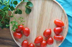 Wooden tray background with fresh tomato Stock Photography