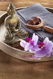 Wooden tray with Buddha and orchid flowers for spirituality and massage Royalty Free Stock Photo