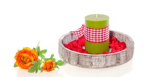 A wooden tray with a candle Royalty Free Stock Photos