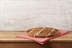 Wooden tray with checked tablecloth on table over rustic backgro Stock Photos