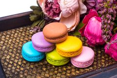 Wooden tray with flowers and macaroons Stock Images