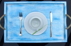 Wooden tray with handles. For Breakfast with Cup, plate and Cutlery Stock Images
