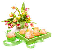 Lemon muffins and tulips isolated on white Royalty Free Stock Photo
