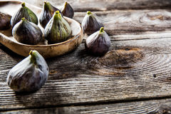 Wooden tray with ripe figs on wood background Royalty Free Stock Images