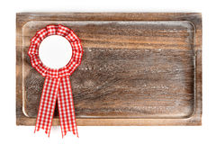 Wooden tray with round ribbon seal or badge, isolated. On white background royalty free stock photography