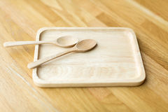 Wooden tray and spoon Royalty Free Stock Photos