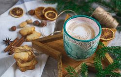 Wooden Tray Star Cup with Coffee Cappuccino Christmas Morning Cookies Decoration New Year Concept Winter Mood. Fir Tree Branch royalty free stock image