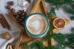 Wooden Tray Star Cup with Coffee Cappuccino Christmas Morning Cookies Decoration New Year Concept Winter Mood. Fir Tree Branch stock photo