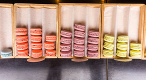 Wooden trays filled with gourmet French macaroons Stock Photo