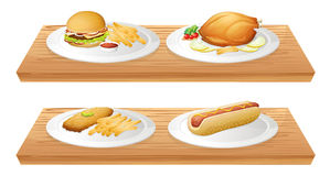 Wooden trays with plates of foods Stock Images