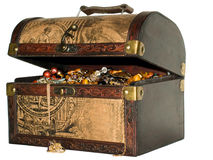 A wooden treasure chest. Filled with loot royalty free stock images