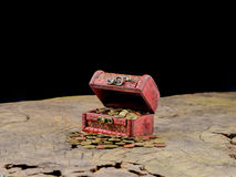 Wooden treasure chest with gold coins. On old wood royalty free stock photos