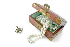 Wooden treasure chest with jewelry Stock Photos