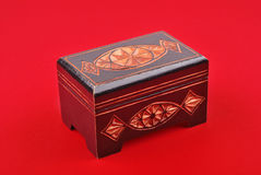 Wooden treasure chest on red Stock Images
