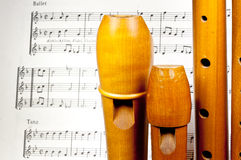 Wooden treble recorders with sheet music Stock Photos