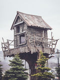Wooden tree house with a retro filter Royalty Free Stock Photo