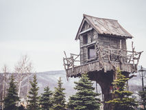Wooden tree house with a retro filter Royalty Free Stock Photography