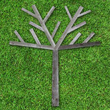 Wooden tree made of wood on green grass. For fill object or photo Stock Image