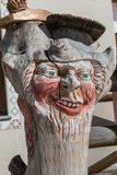 Wooden Tree Sculpture: Close-up of Face Carved in Wood, Handmade.  Royalty Free Stock Image