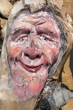 Wooden Tree Sculpture: Close-up of Face Carved in Wood, Handmade.  Stock Photos