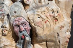 Wooden Tree Sculpture: Close-up of Faces Carved in Wood, Handmad. E Stock Image