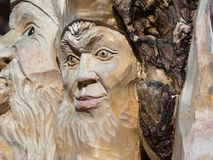 Wooden Tree Sculpture: Close-up of Faces Carved in Wood, Handmad. E Stock Photography