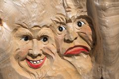 Wooden Tree Sculpture: Close-up of Faces Carved in Wood, Handmad. E Stock Photo